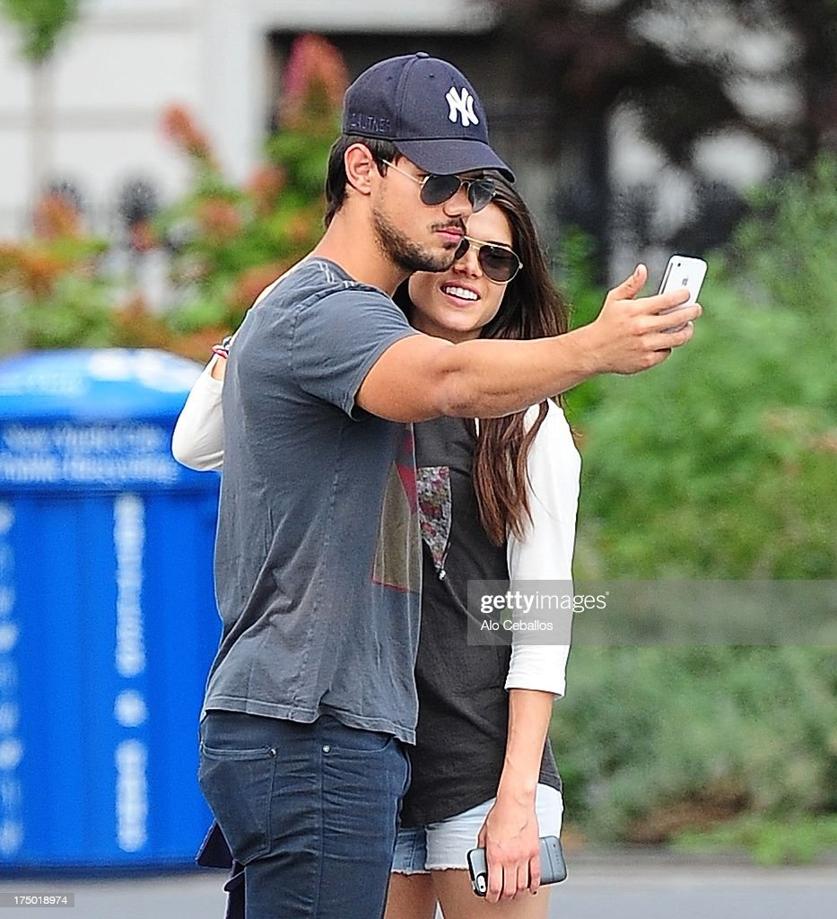 <a gi-track='captionPersonalityLinkClicked' href=/galleries/search?phrase=Taylor+Lautner&family=editorial&specificpeople=228959 ng-click='$event.stopPropagation()'>Taylor Lautner</a> and <a gi-track='captionPersonalityLinkClicked' href=/galleries/search?phrase=Marie+Avgeropoulos&family=editorial&specificpeople=6709928 ng-click='$event.stopPropagation()'>Marie Avgeropoulos</a> are seen in Soho on July 29, 2013 in New York City.