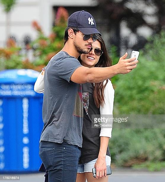 Taylor Lautner and Marie Avgeropoulos are seen in Soho on July 29 2013 in New York City