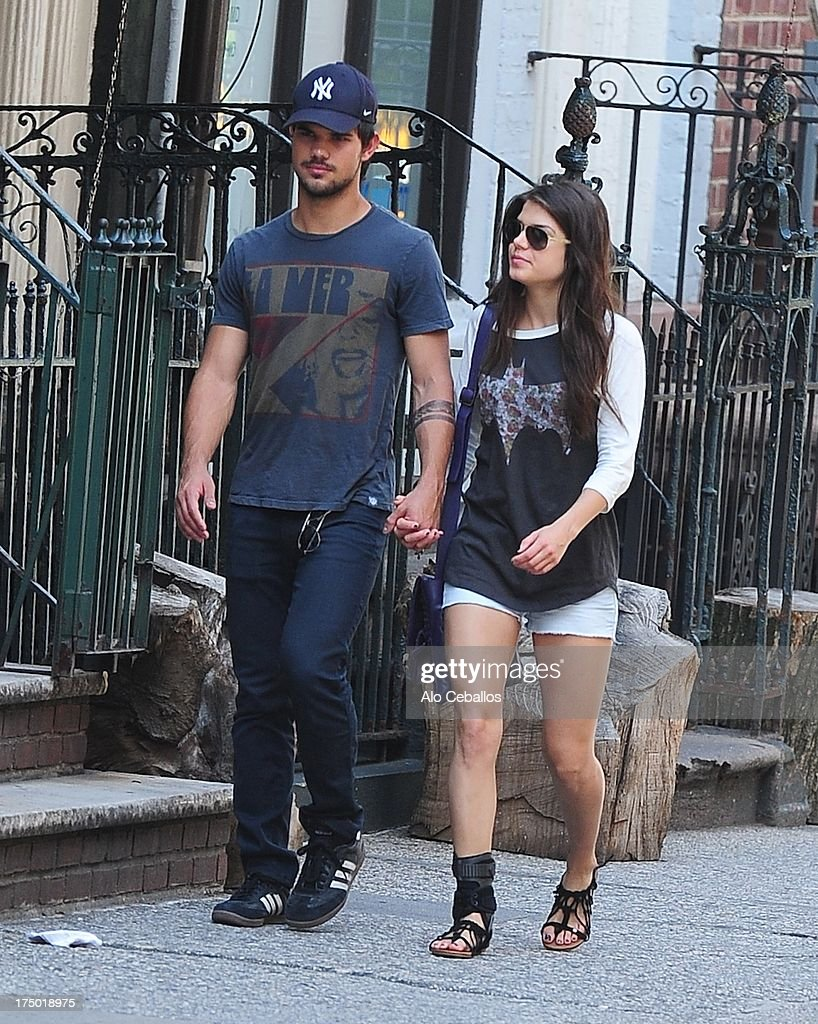 Taylor Lautner and Marie Avgeropoulos are seen in Soho on July 29, 2013 in New York City.
