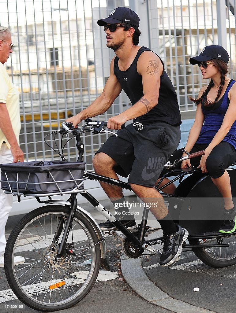 Taylor Lautner and Marie Avgeropoulos are seen in the West Side Highway on July 23, 2013 in New York City.