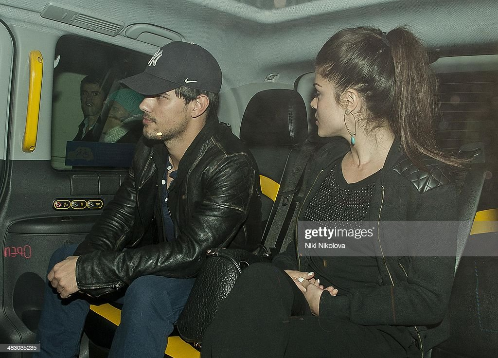 Taylor Lautner and Marie Avgeropoulos are seen leaving Chotto Matte restaurant, Soho on April 5, 2014 in London, England.