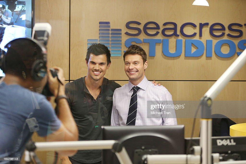 Taylor Lautner (L) and Ryan Seacrest attend The Ryan Seacrest Foundation West Coast debut of new multi-media broadcast center 'Seacrest Studios' held at CHOC Children's Hospital on March 22, 2013 in Orange, California.