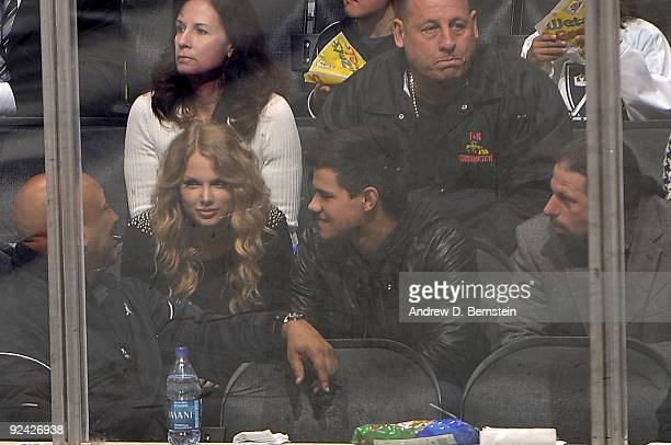 Taylor Lautner and Taylor Swift attend the NHL game between the Columbus Blue Jackets and the Los Angeles Kings during the game on October 25 2009 at...