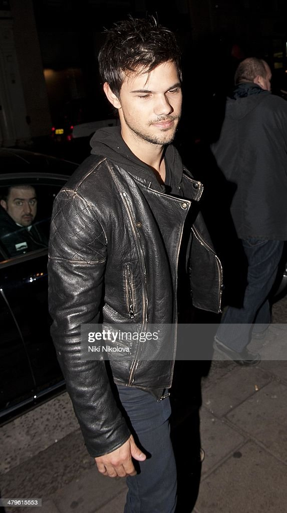 Taylor Lautner is seen arriving at the Mayfair Bar on March 19, 2014 in London, England.