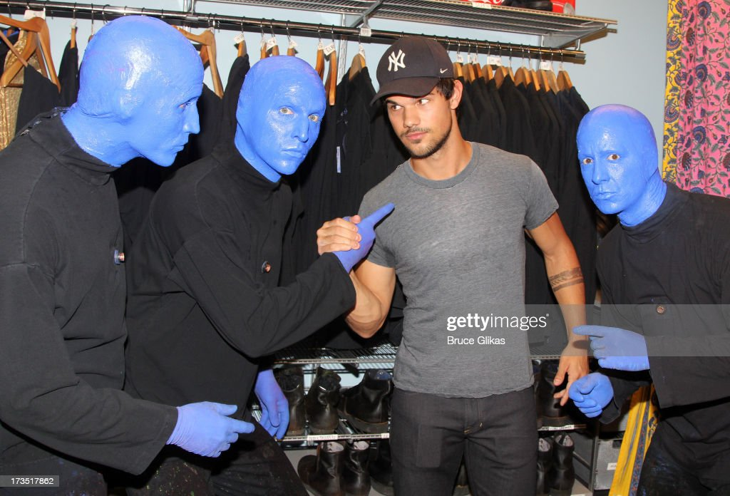 <a gi-track='captionPersonalityLinkClicked' href=/galleries/search?phrase=Taylor+Lautner&family=editorial&specificpeople=228959 ng-click='$event.stopPropagation()'>Taylor Lautner</a> poses backstage at the hit show 'Blue Man Group' Off-Broadway at The Astor Place Theater on July 15, 2013 in New York City.