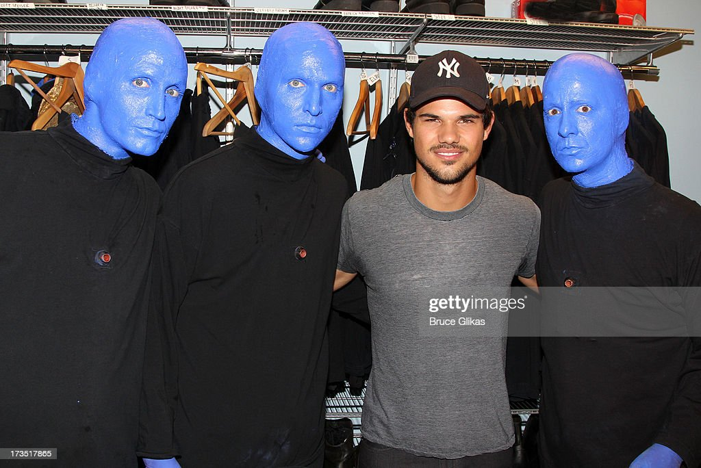 Taylor Lautner poses backstage at the hit show 'Blue Man Group' Off-Broadway at The Astor Place Theater on July 15, 2013 in New York City.