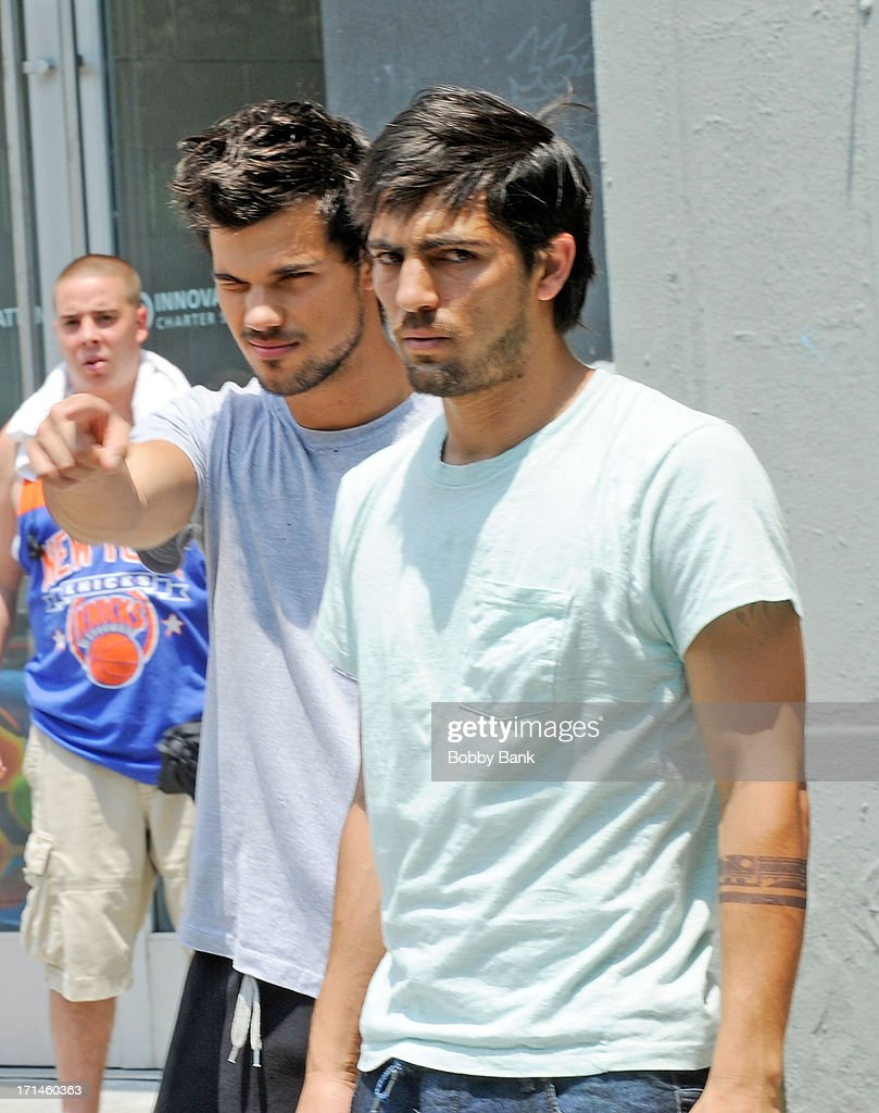 Taylor Lautner with his stunt double on the set of 'Tracers' on June 24, 2013 in New York City.
