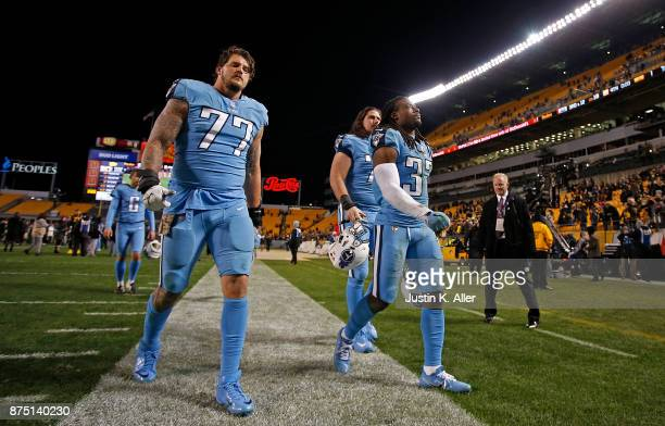 Taylor Lewan of the Tennessee Titans and Johnathan Cyprien walk off the field at the conclusion of the Pittsburgh Steelers 4017 win over the...