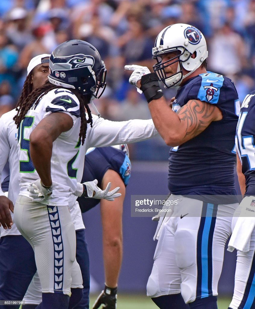 14b5786ae ... Taylor Lewan 77 of the Tennessee Titans gets in the face of Richard  Sherman Taylor Lewan Jersey ...