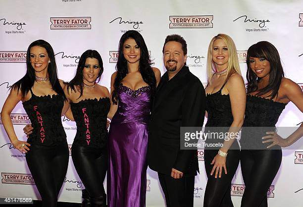 Taylor Makakoa and Terry Fator pose for photos with the cast of Fantacy at Terry Fator's one year anniversary show at The Mirage Hotel and Casino on...