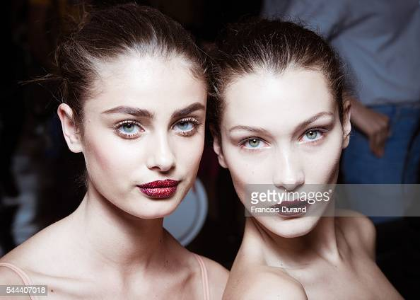 Taylor Marie Hill and Bella Hadid pose Backstage prior the Atelier Versace Haute Couture Fall/Winter 20162017 show as part of Paris Fashion Week on...