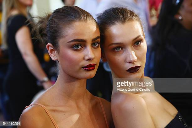 Taylor Marie Hill and Bella Hadid prepare backstage prior to the Atelier Versace Haute Couture Fall/Winter 20162017 show as part of Paris Fashion...