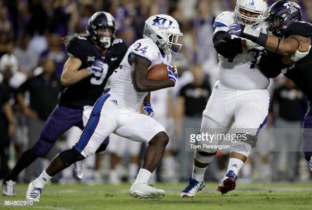 Taylor Martin of the Kansas Jayhawks carries the ball against the TCU Horned Frogs in the first quarter at Amon G Carter Stadium on October 21 2017...
