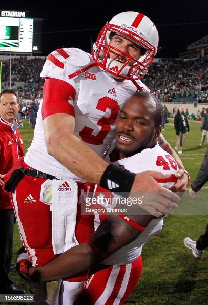 Taylor Martinez of the Nebraska Cornhuskers celebrates a 2824 win over the Michigan State Spartans with Eric Martin at Spartan Stadium Stadium on...