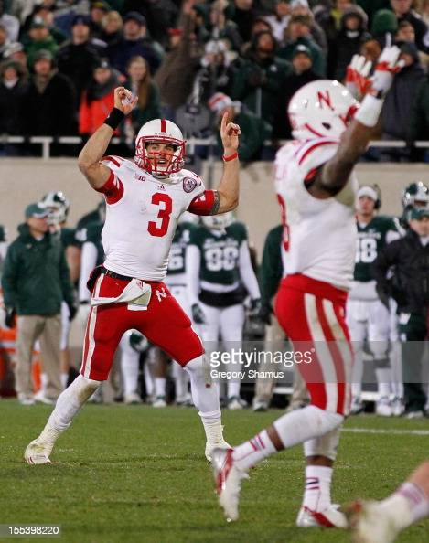 Taylor Martinez of the Nebraska Cornhuskers celebrates throwing a late fourth quarter touchdown to beat the Michigan State Spartans 2824 at Spartan...
