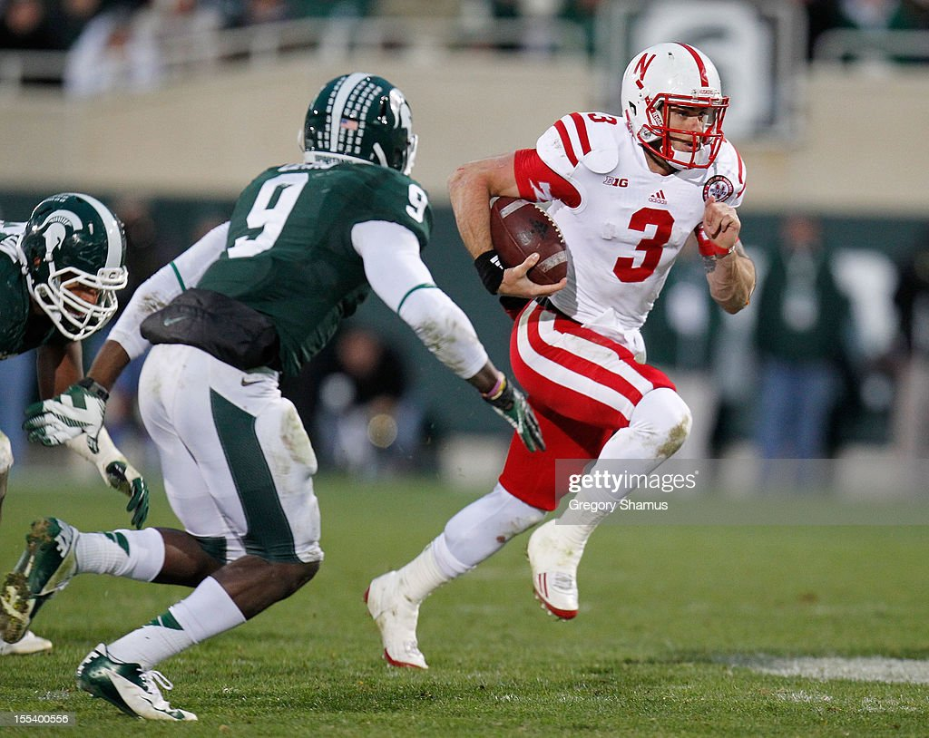 <a gi-track='captionPersonalityLinkClicked' href=/galleries/search?phrase=Taylor+Martinez&family=editorial&specificpeople=7175179 ng-click='$event.stopPropagation()'>Taylor Martinez</a> #3 of the Nebraska Cornhuskers looks for room to run next to Isaiah Lewis #9 of the Michigan State Spartans during a fourth quarter run at Spartan Stadium Stadium on November 3, 2012 in East Lansing, Michigan. Nebraska won the game 28-24.