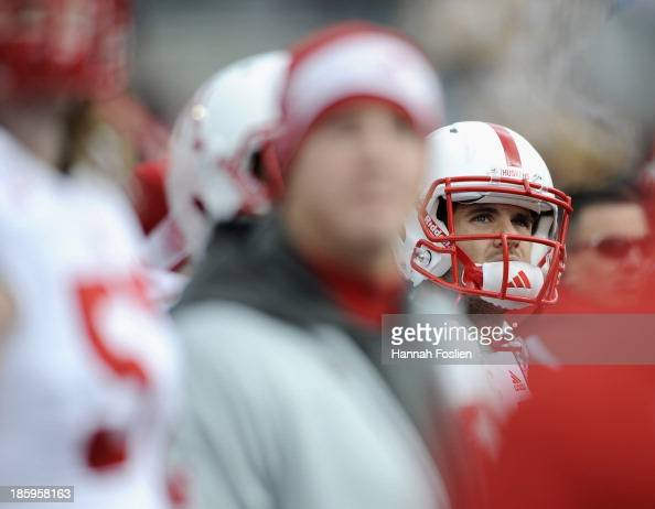 Taylor Martinez of the Nebraska Cornhuskers looks on from the bench during the third quarter of the game against the Minnesota Golden Gophers on...