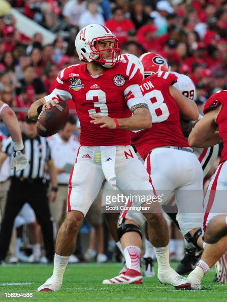 Taylor Martinez of the Nebraska Cornhuskers passes against the Georgia Bulldogs during the Capital One Bowl at the Citrus Bowl on January 1 2013 in...