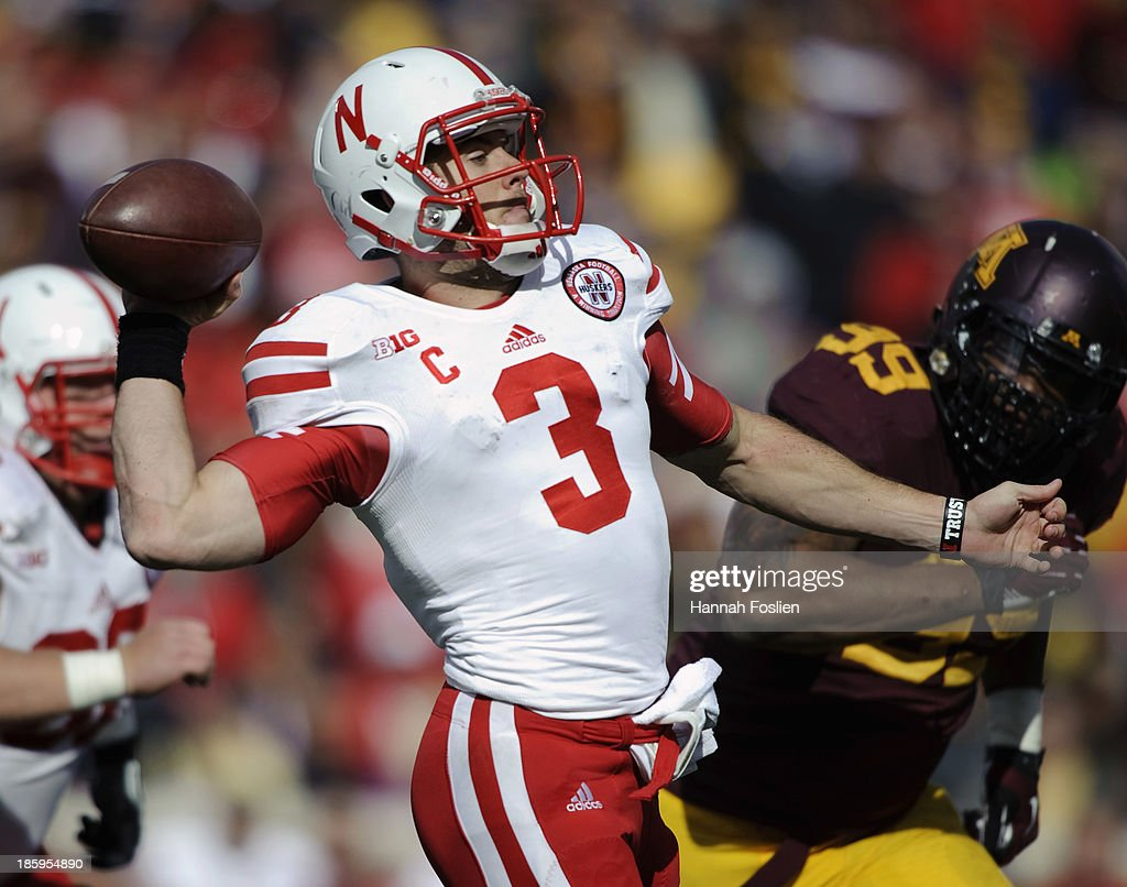 <a gi-track='captionPersonalityLinkClicked' href=/galleries/search?phrase=Taylor+Martinez&family=editorial&specificpeople=7175179 ng-click='$event.stopPropagation()'>Taylor Martinez</a> #3 of the Nebraska Cornhuskers passes the ball during the third quarter of the game against the Minnesota Golden Gophers on October 26, 2013 at TCF Bank Stadium in Minneapolis, Minnesota. The Golden Gophers defeated the Cornhuskers 34-23.