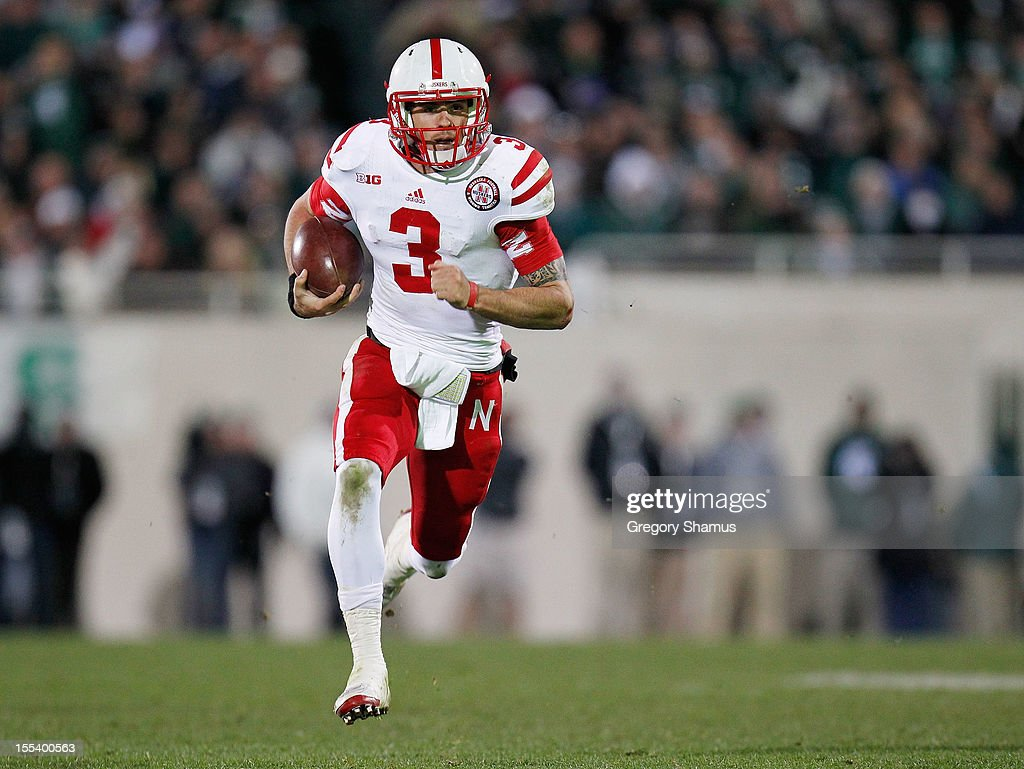<a gi-track='captionPersonalityLinkClicked' href=/galleries/search?phrase=Taylor+Martinez&family=editorial&specificpeople=7175179 ng-click='$event.stopPropagation()'>Taylor Martinez</a> #3 of the Nebraska Cornhuskers runs for a fourth quarter 35 yard touchdown while playing the Michigan State Spartans at Spartan Stadium Stadium on November 3, 2012 in East Lansing, Michigan. Nebraska won the game 28-24.