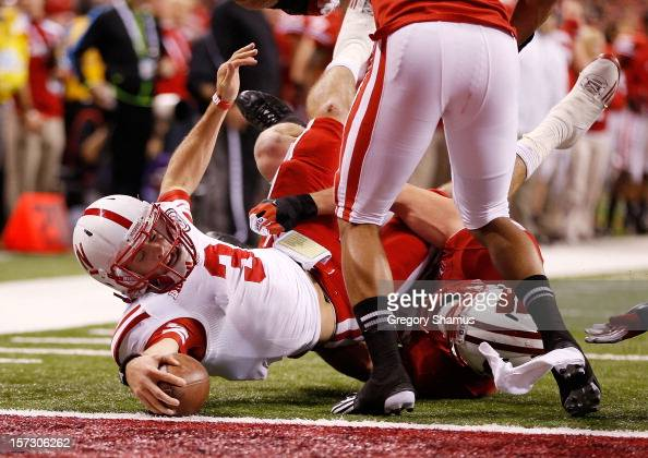 Taylor Martinez of the Nebraska Cornhuskers stretches for a third quarter touchdown during the Big 10 Conference Championship Game at Lucas Oil...