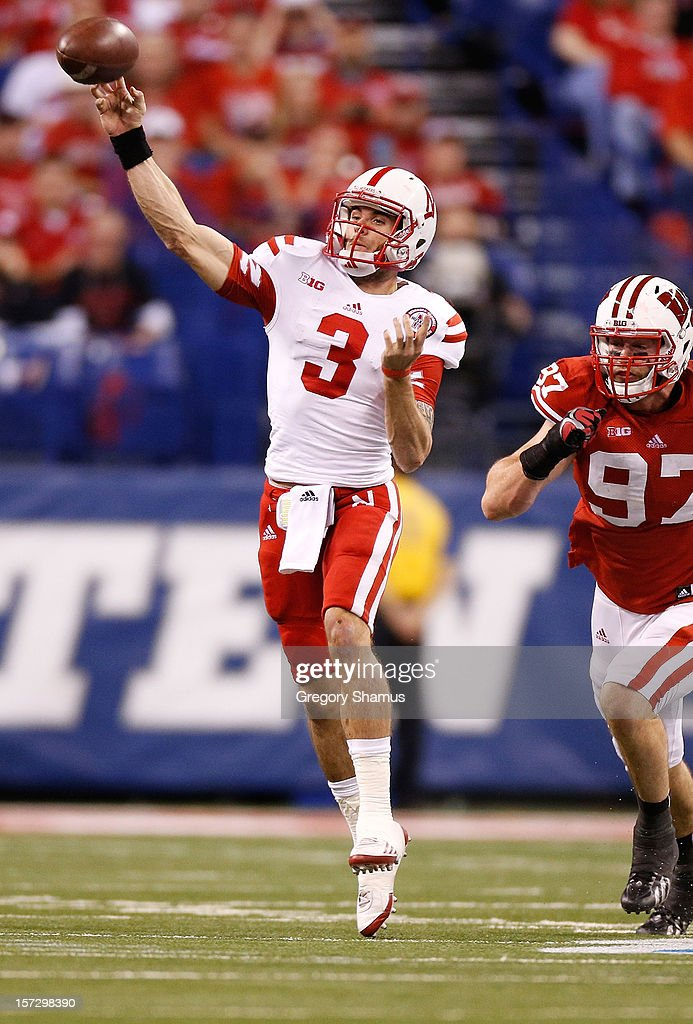 Taylor Martinez #3 of the Nebraska Cornhuskers throws a first quarter pass in front of Brendan Kelly #97 of the Wisconsin Badgers during the Big 10 Conference Championship Game at Lucas Oil Stadium on December 1, 2012 in Indianapolis, Indiana.
