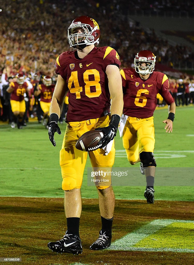 Taylor McNamara #48 of USC Trojans reacts to his touchdown in front of <a gi-track='captionPersonalityLinkClicked' href=/galleries/search?phrase=Cody+Kessler&family=editorial&specificpeople=9870723 ng-click='$event.stopPropagation()'>Cody Kessler</a> #6 to take a 28-0 lead over the Arkansas State Red Wolves during the second quarter at Los Angeles Coliseum on September 5, 2015 in Los Angeles, California.