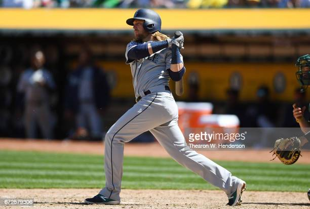 Taylor Motter of the Seattle Mariners bats against the Oakland Athletics in the top of the six inning at Oakland Alameda Coliseum on April 23 2017 in...