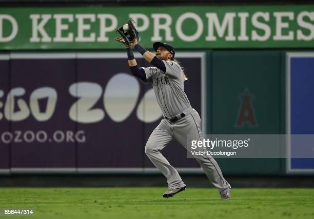 Taylor Motter of the Seattle Mariners catches a flyball to right field during the third inning of the MLB game against the Los Angeles Angels of...