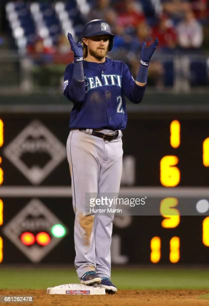 Taylor Motter of the Seattle Mariners celebrates after hitting an RBI double in the ninth inning during a game against the Philadelphia Phillies at...