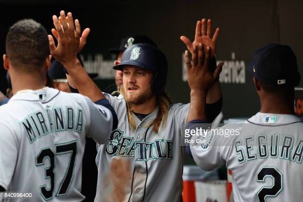Taylor Motter of the Seattle Mariners celebrates scoring a run against the Baltimore Orioles in the third inning at Oriole Park at Camden Yards on...