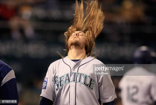 Taylor Motter of the Seattle Mariners flips his hair after hitting a tworun home run in the sixth inning against the Oakland Athletics at Oakland...