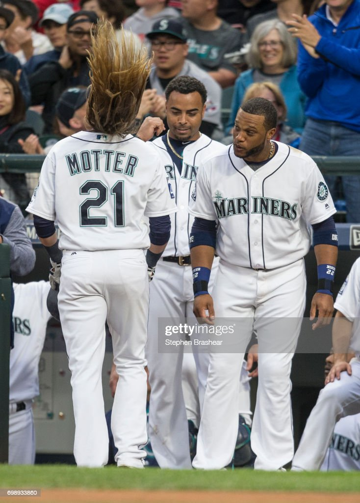 Taylor Motter #21 of the Seattle Mariners flips his hair as he as celebrates hitting solo home run off of starting pitcher Jordan Zimmermann #27 of the Detroit Tigers with Robinson Cano #22, right, of the Seattle Mariners and Nelson Cruz #23 of the Seattle Mariners during the second inning of a game at Safeco Field on June 20, 2017 in Seattle, Washington.
