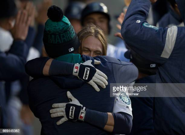 Taylor Motter of the Seattle Mariners gets a hug from Felix Hernandez of the Seattle Mariners after Motter hit a threerun home run in a game against...