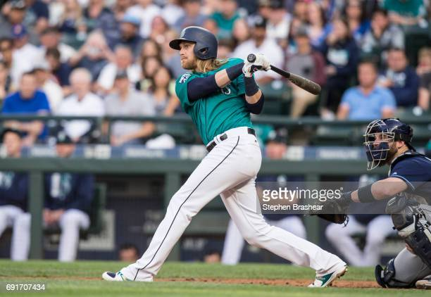 Taylor Motter of the Seattle Mariners hits a grand slam home run off of starting pitcher Jake Odorizzi of the Tampa Bay Rays that scored Guillermo...