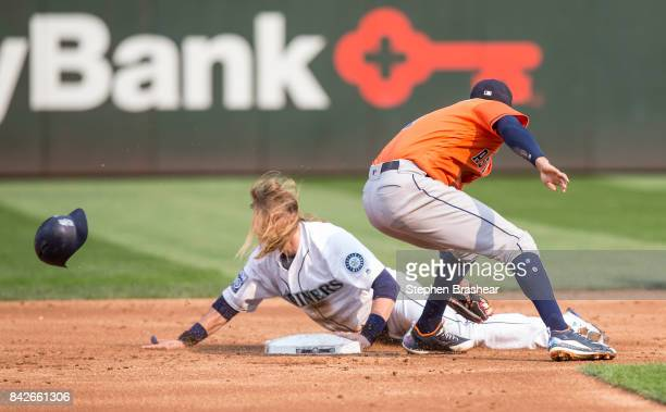 Taylor Motter of the Seattle Mariners steals second base before shortstop Carlos Correa of the Houston Astros can put on a tag during the second...