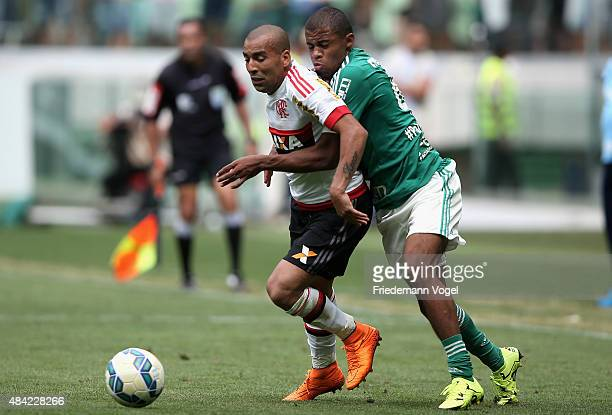 L Taylor of Palmeiras fights for the ball with Emerson of Flamengo during the match between Palmeiras and Flamengo for the Brazilian Series A 2015 at...