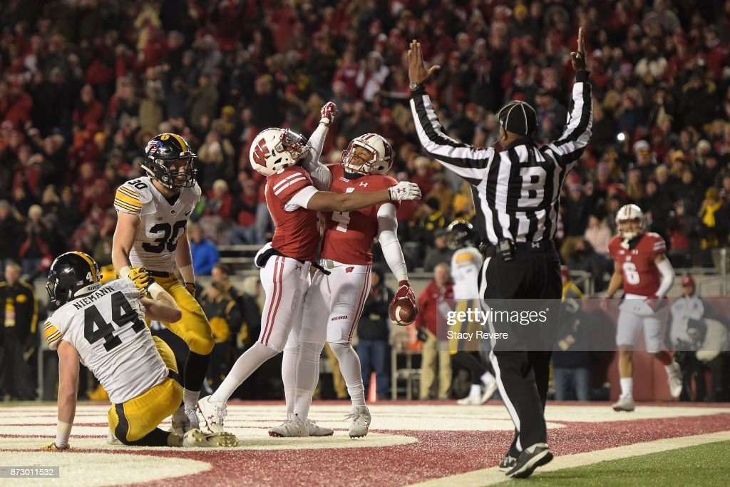 A.J. Taylor #4 of the Wisconsin Badgers is congratulated by Kendric Pryor #3 folllowing a touchdown against the Iowa Hawkeyes during the fourth quarter of a game at Camp Randall Stadium on November 11, 2017 in Madison, Wisconsin.