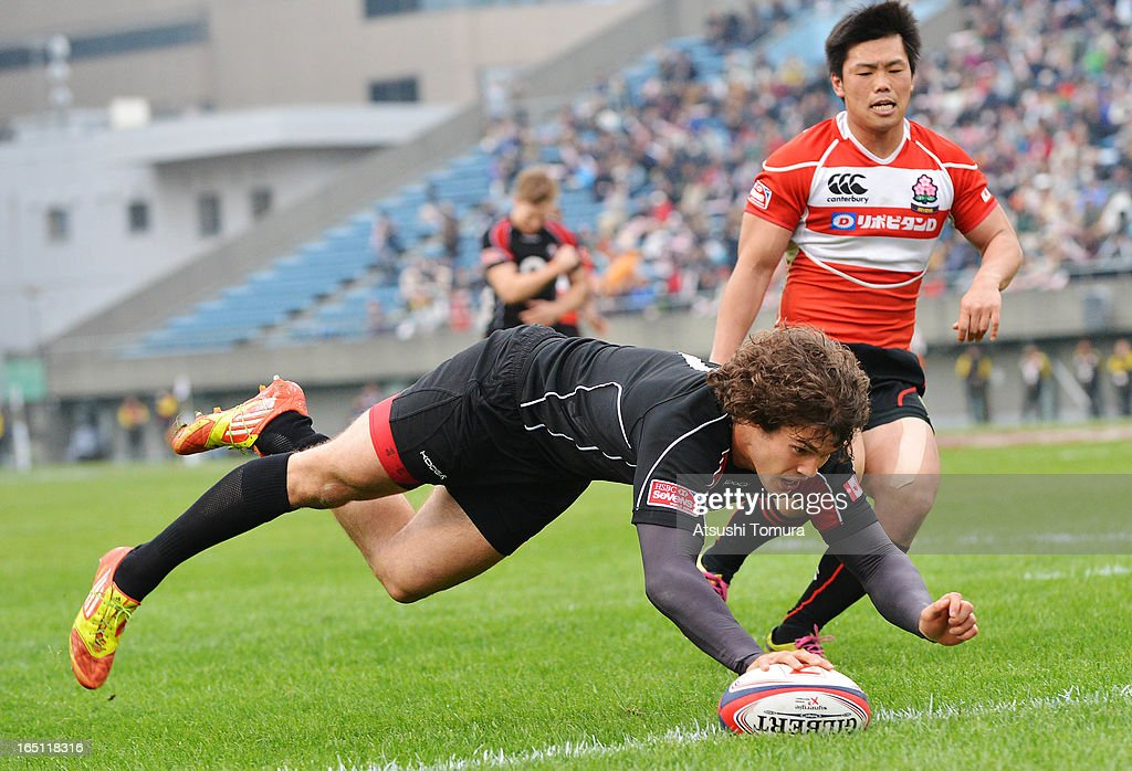 Taylor Paris of Canada rdives over the line to score a try during the match against Japan on day two of the HSBC Sevens Tokyo at Prince Chichibu Stadium on March 31, 2013 in Tokyo, Japan.