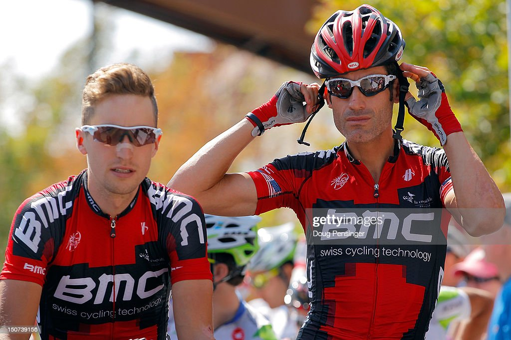 Taylor Phinney and George Hincapie of BMC Racing prepare for the start of stage six of the USA Pro Challenge from Golden to Boulder on August 25, 2012 in Golden, Colorado.