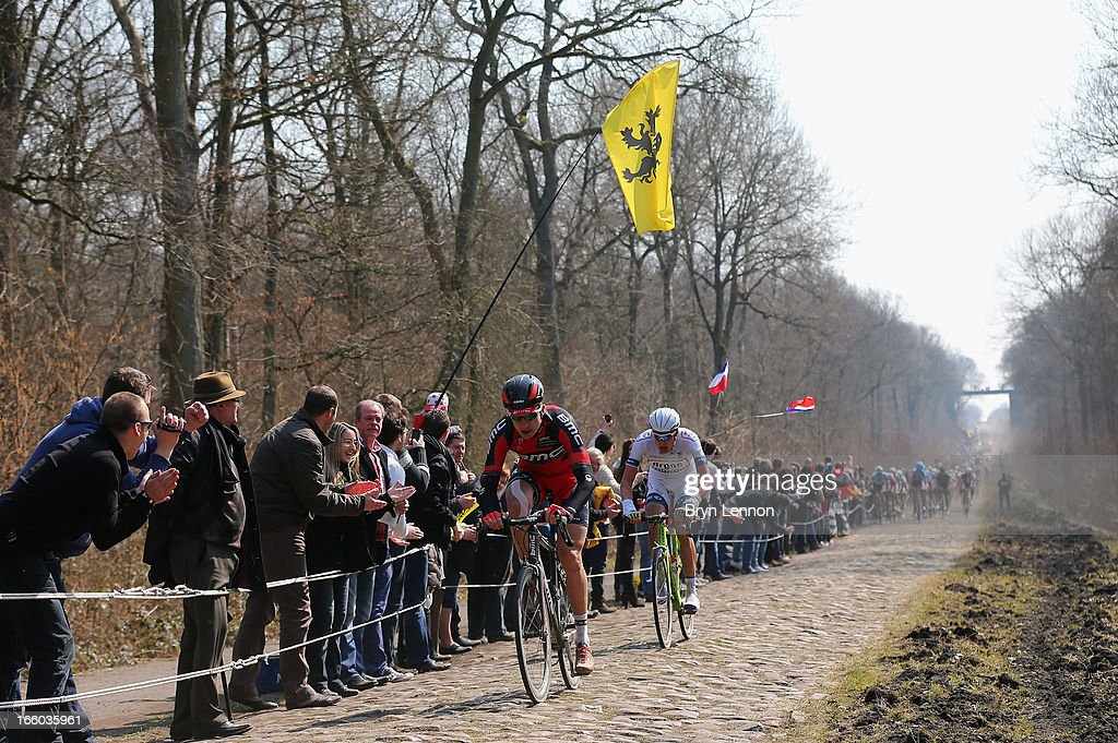 Taylor Phinney of the USA and the BMC Racing Team in action in Arenberg Forest during the 2013 Paris - Roubaix race from Compiegne to Roubaix on April 7, 2013 in Roubaix, France. The 111th Paris - Roubaix race is 254km long and contains 27 sections of cobblestones.