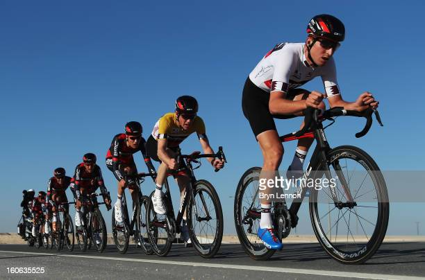 Taylor Phinney of the USA leads race leader Brent Bookwalter of the USA and their BMC Racing Team on stage two of the 2013 Tour of Qatar a 14km Team...