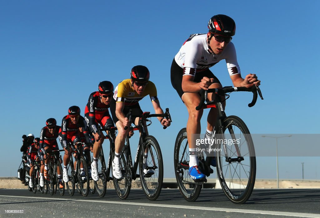 Taylor Phinney of the USA leads race leader Brent Bookwalter of the USA and their BMC Racing Team on stage two of the 2013 Tour of Qatar, a 14km Team Time Trial along Al Rufaa Street on February 4, 2013 in Doha, Qatar.