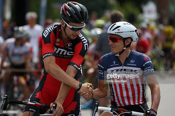 Taylor Phinney of United States riding for BMC Racing and Matthew Busche of United States riding for Trek Factory Racing shake hands on the start...