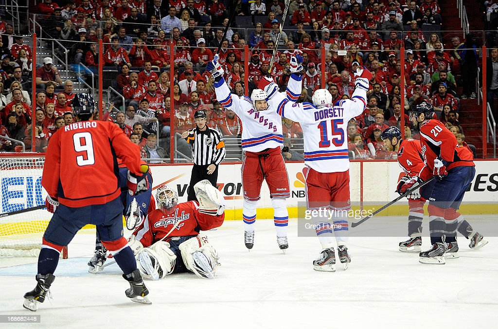 <a gi-track='captionPersonalityLinkClicked' href=/galleries/search?phrase=Taylor+Pyatt&family=editorial&specificpeople=204508 ng-click='$event.stopPropagation()'>Taylor Pyatt</a> #14 of the New York Rangers celebrates with <a gi-track='captionPersonalityLinkClicked' href=/galleries/search?phrase=Derek+Dorsett&family=editorial&specificpeople=4306277 ng-click='$event.stopPropagation()'>Derek Dorsett</a> #15 after scoring in the second period against the Washington Capitals in Game Seven of the Eastern Conference Quarterfinals during the 2013 NHL Stanley Cup Playoffs at the Verizon Center on May 13, 2013 in Washington, DC.