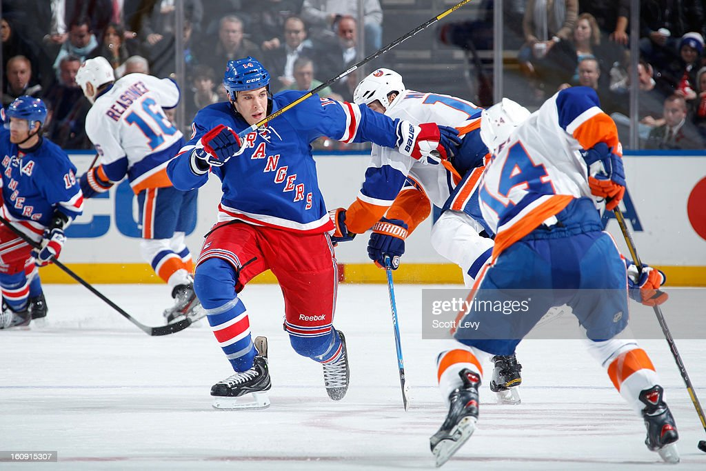 <a gi-track='captionPersonalityLinkClicked' href=/galleries/search?phrase=Taylor+Pyatt&family=editorial&specificpeople=204508 ng-click='$event.stopPropagation()'>Taylor Pyatt</a> #14 of the New York Rangers skates against Thomas Hickey #14 of the New York Islanders at Madison Square Garden on February 7, 2013 in New York City. The Rangers defeat the Islanders 4-1.