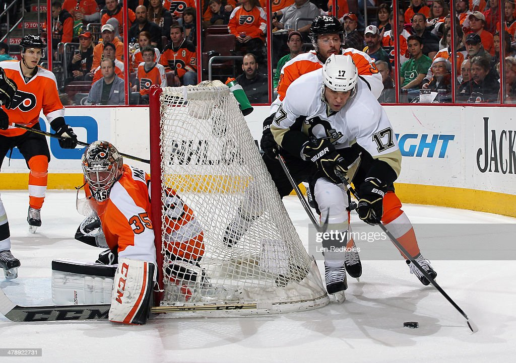 <a gi-track='captionPersonalityLinkClicked' href=/galleries/search?phrase=Taylor+Pyatt&family=editorial&specificpeople=204508 ng-click='$event.stopPropagation()'>Taylor Pyatt</a> #17 of the Pittsburgh Penguins controls the puck behind the net of Steve Mason #35 of the Philadelphia Flyers while being pursued by <a gi-track='captionPersonalityLinkClicked' href=/galleries/search?phrase=Mark+Streit&family=editorial&specificpeople=636976 ng-click='$event.stopPropagation()'>Mark Streit</a> #32 on March 15, 2014 at the Wells Fargo Center in Philadelphia, Pennsylvania. The Flyers went on to defeat the Penguins 4-0.