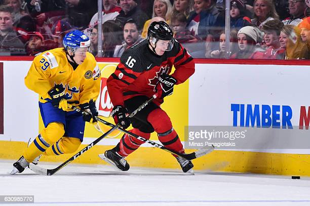 Taylor Raddysh of Team Canada and Tim Soderlund of Team Sweden chase the puck during the 2017 IIHF World Junior Championship semifinal game at the...