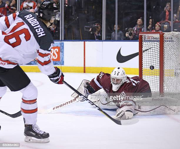 Taylor Raddysh of Team Canada fires a shot past Mareks Mitens of Team Latvia during a preliminary game in the 2017 IIHF World Junior Hockey...