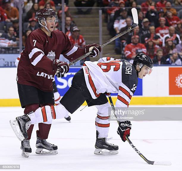 Taylor Raddysh of Team Canada gets bumped by Maksims Ponomarenko of Team Latvia during a preliminary game in the 2017 IIHF World Junior Hockey...
